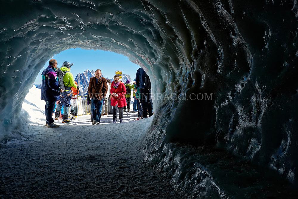 Tourists walking through the Aiguille du Midi Ice Tunnel, Chamonix, France