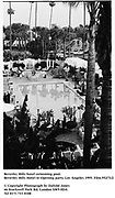 Beverley Hills hotel swimming pool. Beverley Hills Hotel re-Opening party. Los Angeles 1995. Film.95273/2 <br />© Copyright Photograph by Dafydd Jones<br />66 Stockwell Park Rd. London SW9 0DA<br />Tel 0171 733 0108