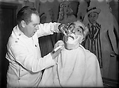 1955 - 23/12 Noel Purcell having his beard Shaved for Pantomime