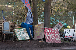Harefield, UK. 17 January, 2020. Signs at Stop HS2's Colne Valley protection camp in the Colne Valley. Activists from Stop HS2 and Extinction Rebellion are beginning a three-day 'Stand for the Trees' protest there timed to coincide with tree felling work by HS2. Bailiffs acting for HS2 have been evicting Stop HS2 activists from the camp for the past week and a half. 108 ancient woodlands are set to be destroyed by the high-speed rail link.