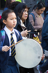 "Westminster, London, March 25th 2016. Westminster's annual interdenominational Easter procession takes place with a procession from Methodist Central Hall to Westminster Cathedral and then on to Westminster Abbey, with the cross borne by people from The Passage, a homeless charity. PICTURED: Her drum beating ""as Jesus' heart"", a girl from St Vincent de Paul Primary School in Victoria helps to give the procession a solemn air. <br /> ©Paul Davey. <br /> <br /> FOR LICENCING CONTACT: Paul Davey +44 (0) 7966 016 296 paul@pauldaveycreative.co.uk"