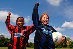 Primary schoolchildren playing football Yorkshire UK
