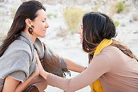 Two Wild Women connecting hearts in desert wilderness nature.