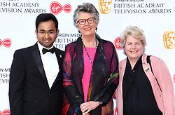 Rahul Mandal, Prue Leith and Sandi Toksvig attending the Virgin Media BAFTA TV awards, held at the Royal Festival Hall in London. Photo credit should read: Doug Peters/EMPICS