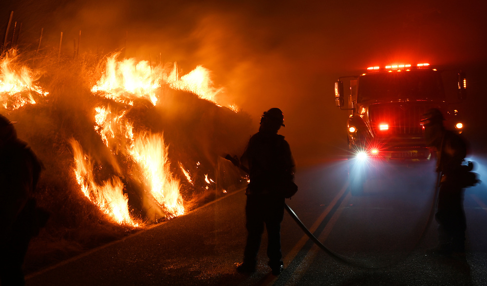 Firefighters control Blackburn to help combat the Crews fire on Canada Road near Gilroy, Calif. on July 5, 2020.