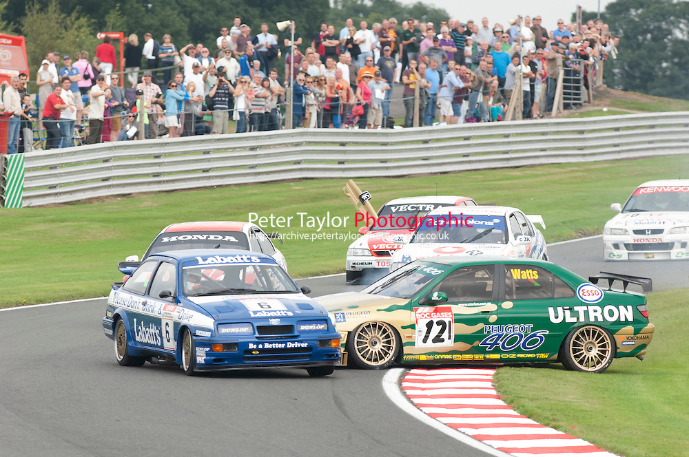6 Smith/Harvey Ford Sierra RS500 and 121 Patrick Watts Peugeot 406 have a little door rubbing in cascades.  HSCC Gold Cup Oulton Park, Cheshire, United Kingdom.  24th-26th August 2013.  Race 4 Super Touring Car Race. World Copyright: Peter Taylor/PSP. Copy of publication required for printed pictures. Every used picture is fee-liable.