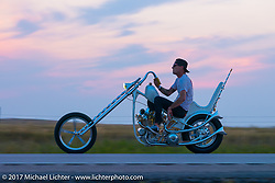 Hawk Lawshe of Vintage technologies in Montana, who built this Shovelhead with backwards heads, riding back to Sturgis from the Full Throttle Saloon during the annual Sturgis Black Hills Motorcycle Rally. Sturgis, SD. USA. Friday August 11, 2017.  Photography ©2017 Michael Lichter.