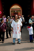 Protester outside the Forbidden City. Slogan says 'Forbidden City - To find the truth' another line is not recognisable.The Forbidden City was the Chinese imperial palace from the Ming Dynasty to the end of the Qing Dynasty. It is located in the middle of Beijing, China, and now houses the Palace Museum. For almost 500 years, it served as the home of emperors and their households, as well as the ceremonial and political center of Chinese government. Built in 1406 to 1420, the complex consists of 980 buildings. The palace complex exemplifies traditional Chinese palatial architecture, and has influenced cultural and architectural developments in East Asia and elsewhere. The Forbidden City was declared a World Heritage Site in 1987, and is listed by UNESCO as the largest collection of preserved ancient wooden structures in the world.