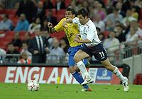 Photo: Richard Lane.<br />England v Brazil. International Friendly. 01/06/2007. <br />England's Joe Cole breaks past Brazil's Daniel Alves.