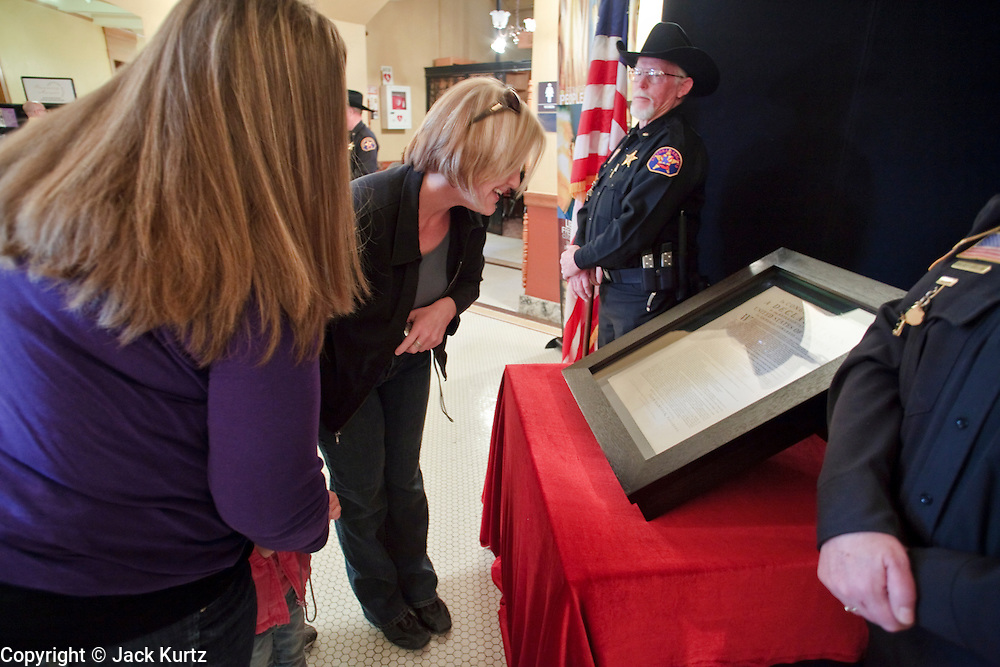Feb. 20, 2010 -- PHOENIX, AZ:  People view one of the few remaining original copies of the Declaration of Independence in the historic Arizona State Capitol. Only 26 copies of the original Declaration of Independence are known to exist today after 200 were printed by John Dunlap, a colonial era printer, who was ordered to print the Declaration by the Continental Congress in 1776. Most of them are housed at universities, public libraries, city halls or other government institutions. The copy brought to Phoenix, the 25th of the 200, was found in 1989, tucked behind a painting bought at a flea market for $4, according to the Pearson Foundation, a non-profit organization that supports education efforts. It is owned by film and TV producer Norman Lear and a friend. They are making the declaration available for public viewing through the Declare Yourself Foundation, which focuses on registering people ages 18 to 29 to vote and getting them involved in local and national elections.      Photo by Jack Kurtz