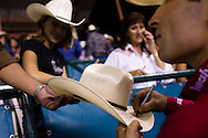 Guilherme Marchi signs autographs after the PBR Rodeo in Del Mar, California