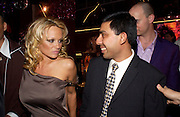 Pamela Anderson and Rutam Deb. Selfridges Las Vegas dinner hosted by  hon Galen , Hillary Weston and Allanah Weston. Selfridges Oxford St. 20 April 2005. ONE TIME USE ONLY - DO NOT ARCHIVE  © Copyright Photograph by Dafydd Jones 66 Stockwell Park Rd. London SW9 0DA Tel 020 7733 0108 www.dafjones.com