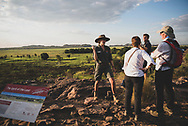 Kakadu National Park, Australia - September 5, 2017: Standing at Ubirr lookout at Kakadu National Park in Australia's Northern Territory, Phoebe Reeve, a ranger for Parks Australia, speaks to a walking tour group. Behind her is the Nadab floodplain and Arnhem Land.