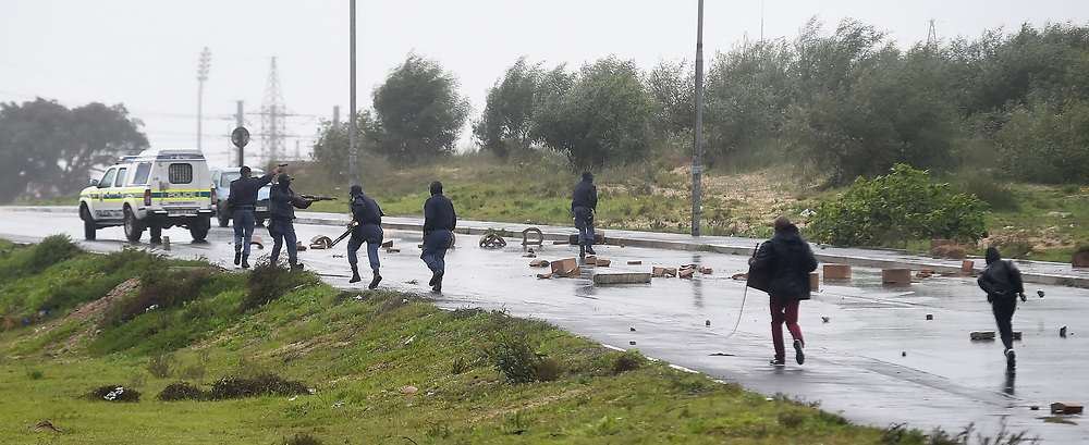 SOUTH AFRICA - Cape Town - 9 July  2020  - Police fire rubber bullet at protesting Mfuleni residents and backyarders who were protesting for houses on the Hindle Road.They burnt tyres and rubble and blocked the road with bricks and rocks. Picture: Phando Jikelo/African News Agency(ANA)