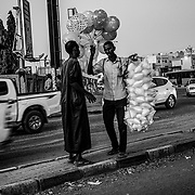 A street vendor sells balloons and cotton candy on one of the main roads in Khartoum, Sudan on December 12, 2020. After the fall of ex-President Al-Bashir, the new government inherited a bankrupt state burdened by the consequences of international sanctions. Although assisted by the World Bank and the IMF, the country remains mired in the economic crisis. Byron Smith for Libération