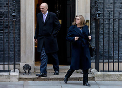 © Licensed to London News Pictures. 26/02/2019. London, UK. Transport Secretary Chris Grayling (L) and Secretary of State for International Development Penny Mordaunt (R) leave 10 Downing Street after the Cabinet meeting. Photo credit: Rob Pinney/LNP