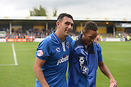 Gary Roberts of Portsmouth celebrates after the final whistle with Kyle Bennett of Portsmouth. Skybet football league two match, Cambridge Utd v Portsmouth at the Abbey Stadium  in Cambridge on Saturday 10th October 2015.<br /> pic by John Patrick Fletcher, Andrew Orchard sports photography.