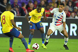 March 21, 2019 - Orlando, Florida, USA - US midfielder Tyler Adams (14) and Ecuador midfielder Jhegson Mendez (20) go for a ball during an international friendly between the US and Ecuador at Orlando City Stadium on March 21, 2019 in Orlando, Florida. .The US won the game 1-0...©2019 Scott A. Miller. (Credit Image: © Scott A. Miller/ZUMA Wire)