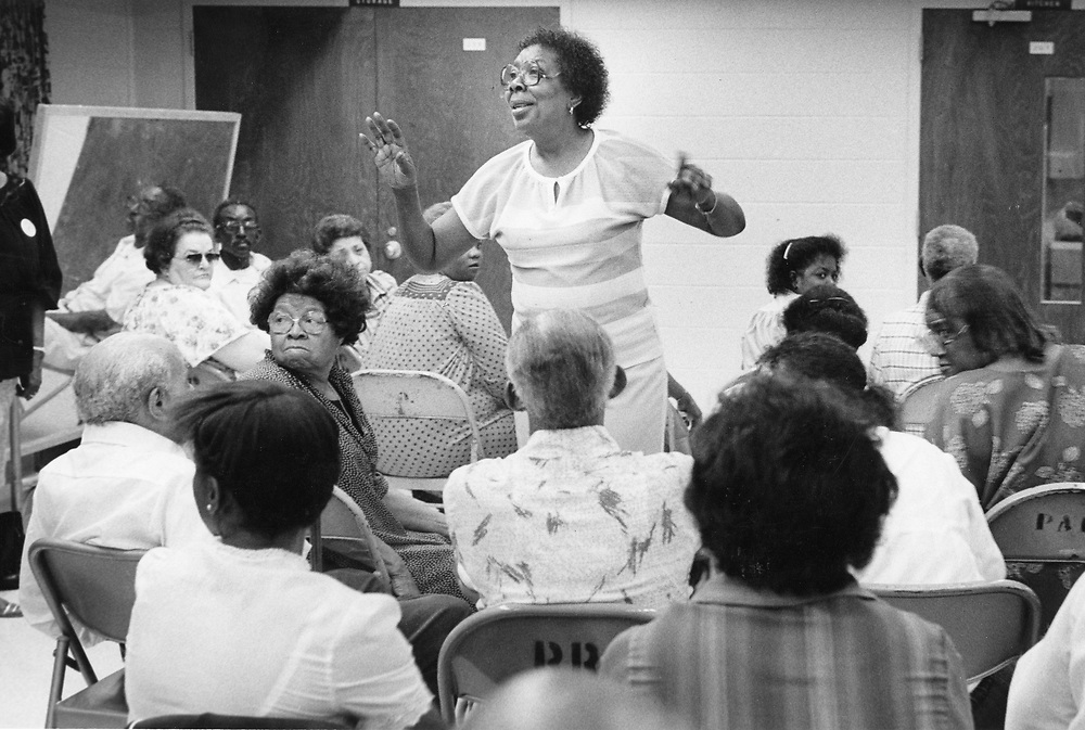 ©1991 Public Speaking:  Precinct chair running a caucus meeting after primary election, east Austin historically Black area.