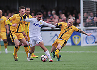 Football - 2016 / 2017 FA Cup - Fourth Round: Sutton United vs. Leeds United<br /> <br /> Kemar Roofe of Leeds and Nicky Bailey of Sutton at Gander Green Lane.<br /> <br /> COLORSPORT/ANDREW COWIE