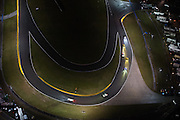 January 26-29, 2017: Rolex Daytona 24. Daytona International Speedway at night during the 55th running of the Rolex 24. 4 Corvette Racing, Corvette C7.R, Oliver Gavin, Tommy Milner, Marcel Fassler,  3 Corvette Racing, Corvette C7.R, Antonio Garcia, Jan Magnussen, Mike Rockenfeller, 19 BMW Team RLL, BMW M6, Bill Auberlen, Alexander Sims, Augusto Farfus, Bruno Spengler,  5 Mustang Sampling Racing, DPi, Joao Barbosa, Filipe Albuquerque, Christian Fittipaldi , BMW art car Daytona arial view from a cessna plane