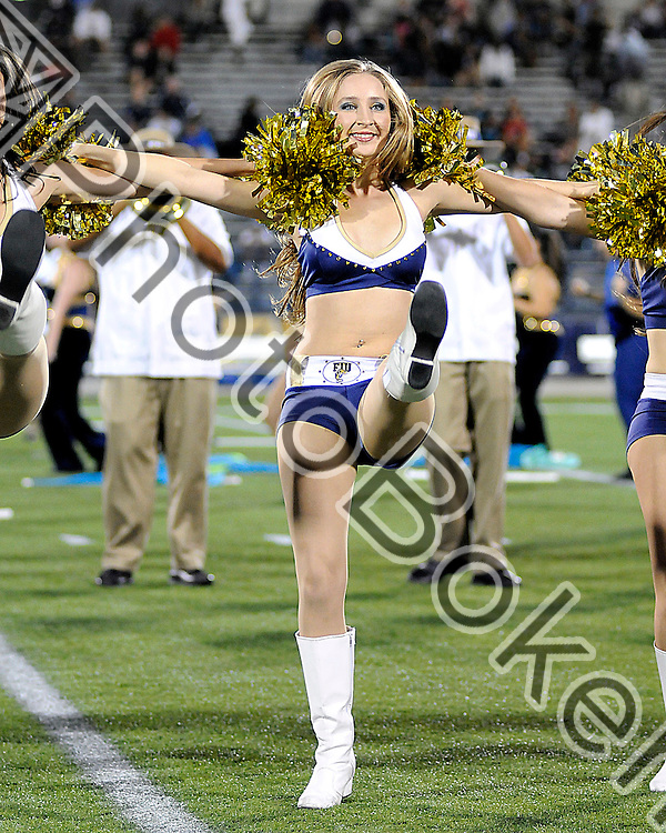 2011 November 12 - FIU Golden Dazzlers dance team on the sidelines. Florida International University Golden Panthers defeated the Florida Atlantic University Owls, 41-7, at Alfonso Field at the FIU Stadium, Miami, Florida. (Photo by: www.photobokeh.com / Alex J. Hernandez) 1/500 f/2.8 ISO1600 157mm
