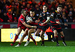 Dragons' Jared Rosser is tackled by Scarlets' Tom Prydie<br /> <br /> Photographer Craig Thomas/Replay Images<br /> <br /> Guinness PRO14 Round 13 - Scarlets v Dragons - Friday 5th January 2018 - Parc Y Scarlets - Llanelli<br /> <br /> World Copyright © Replay Images . All rights reserved. info@replayimages.co.uk - http://replayimages.co.uk