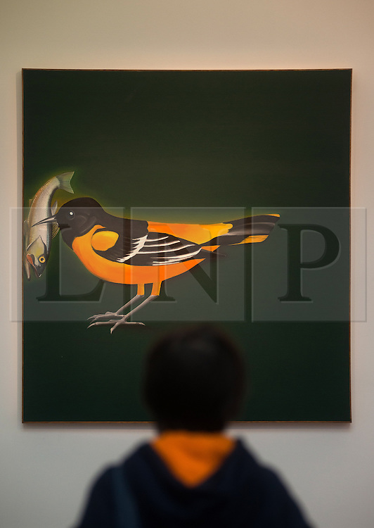 © Licensed to London News Pictures. 12/04/2013. London, UK. A visitor views Ed Ruscha's 'Baltimore Oriole Securing Freshwater Fish? painting with an estimated value of between 3 - 5 million USD for the upcoming New York auctions. Highlights from Sotheby's New York auctions of Impressionist and Modern Art and Contemporary Art will be exhibited to the public from 12-16 April at  Sotheby's London New Bond Street galleries..Photo credit : Peter Kollanyi/LNP