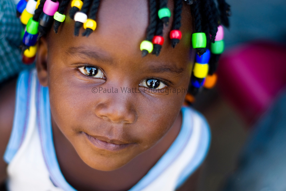 Young African girl with colorful braids and beautiful eyes