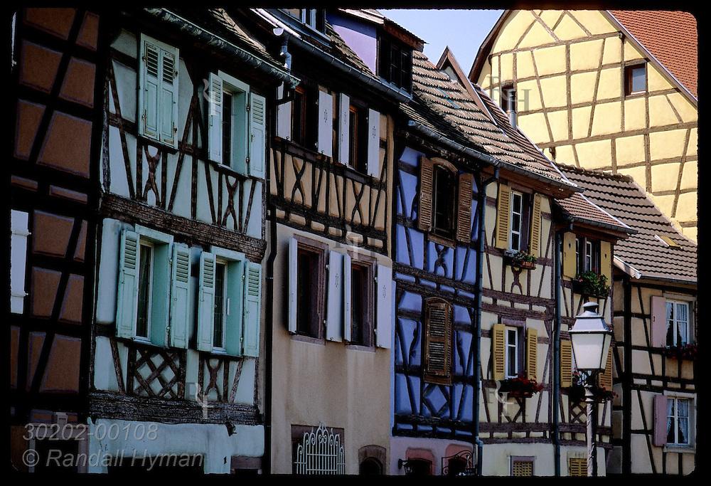 Half-timbered buildings line Quai de la Poissonerie on the Lauch canal; Colmar, Alsace. France