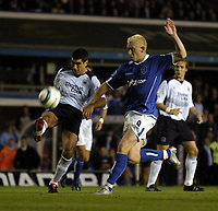 Photo: Richard Lane.Digitalsport<br /> Birmingham City v Manchester City. FA Barclays Premiership. 24/08/2004.<br /> Claudio Reyna clears as Mikael Forssell challenges.