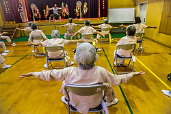Senior inmates take an exercise class at the Iwakuni Prison for women in Iwakuni, Yamaguchi prefecture, Japan. The program is intended for inmates 65 years and older to maintain their health.