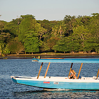 A woman rides a water taxi on the Rio Tortuguero in Tortuguero, Costa Rica on April 7, 2009.  The small village is remote and accessed mainly through water taxis.  (Photo/Billy Byrne Drumm)