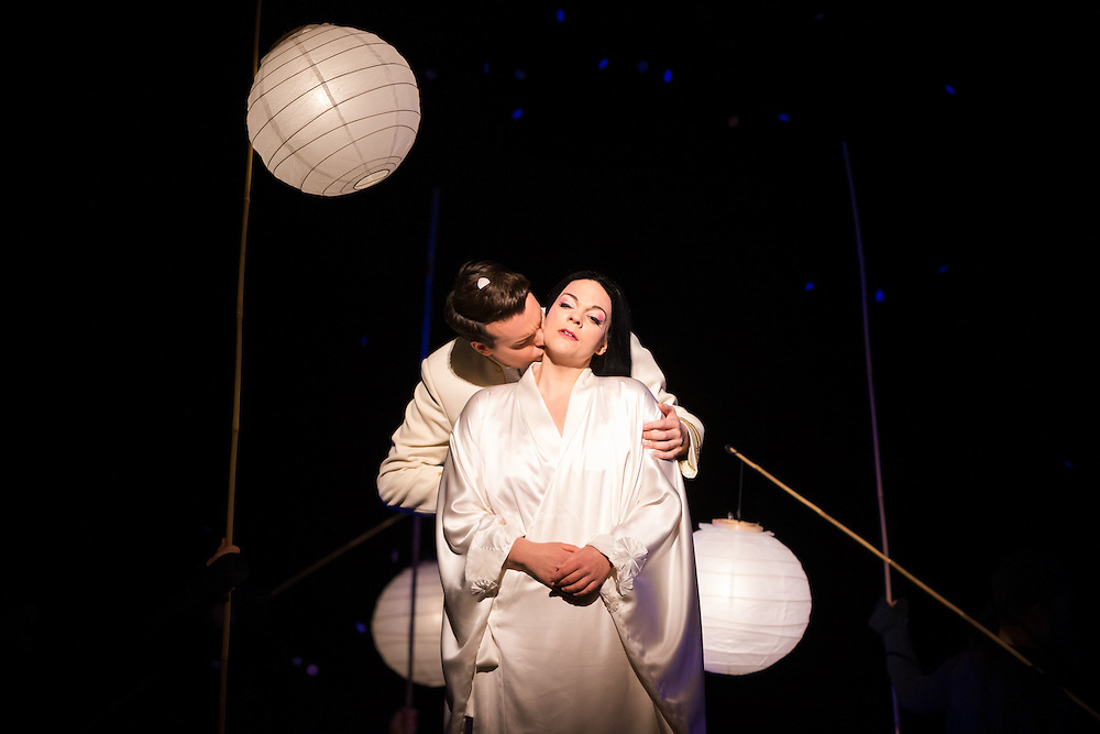 """LONDON, UK, 14 May, 2016. Rina Harms (right, as Butterfly) and David Butt Philip (left, as Pinkerton) rehearse for the revival of director Anthony Minghella's production of Puccini's opera """"Madam Butterfly"""" at the London Coliseum for the English National Opera. The production opens on 16 May. Photo credit: Scott Rylander."""