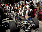 Dan Gurney pushes his F1 Eagle-Weslake through the pits at the 1967 Monaco Grand Prix. Photo by Ozzie Lyons