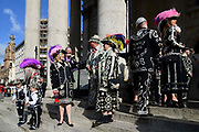 Pearly Kings and Queens on the steps of   St Martin-in-the-Fields church for their annual Harvest Festival on 6th October 2019 in London, United Kingdom. The tradition of the Pearly Kings and Queens originated in the 19th century when London street sweeper Henry Croft decorated his uniform and began collecting money for charity. The annual harvest festival sees Pearly Kings and Queens gather to celebrate the autumn harvest with a church service.