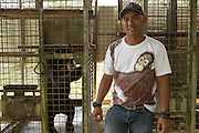 Imam Muslimin, one of keepers, poses for a photograph with a sun bear at the Sun Bear Sanctuary run by the Borneo Orangutan Survival Foundation in the Samboja Lestari conservation area in Kutai Kartanegara district, East Kalimantan, Indonesia, on March 13, 2016. <br /> (Photo: Rodrigo Ordonez)