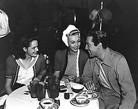 """1941 Cesar Romero, Carole Landis and Virginia """"Peggy"""" McKenna (left) dine at the Hollywood Brown Derby"""