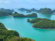 Thailand's Andaman Sea is full of jungle covered limestone islands and incredible blue green water.
