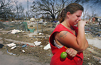 """Photo by Jon M. Fletcher / Staff - 83105 - Grasping a fresh lime she found ripening on a friend's tree, Kelly Grisham crys remembering what was swept away by Hurricane Katrina.<br /> """"It's just wiped us off the map,"""" she said."""