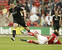 Photo: Aidan Ellis.<br /> Barnsley v Cardiff City. Coca Cola Championship. 29/09/2007.<br /> Cardiff's Gavin Rae loses out to Barnsley's Dennis Souza