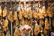 Close up display of cured hams inside a specialist shop in Barrio Macarena, Seville, Spain