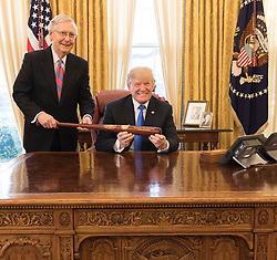 "Donald Trump releases a photo on Instagram with the following caption: ""#TeamTrumpBTS\nToday, President Donald J. Trump is presented with a Louisville Slugger baseball bat with the Presidential Seal by U.S. Senator Majority Leader Mitch McConnell."". Photo Credit: Instagram *** No USA Distribution *** For Editorial Use Only *** Not to be Published in Books or Photo Books ***  Please note: Fees charged by the agency are for the agency's services only, and do not, nor are they intended to, convey to the user any ownership of Copyright or License in the material. The agency does not claim any ownership including but not limited to Copyright or License in the attached material. By publishing this material you expressly agree to indemnify and to hold the agency and its directors, shareholders and employees harmless from any loss, claims, damages, demands, expenses (including legal fees), or any causes of action or allegation against the agency arising out of or connected in any way with publication of the material."