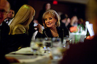 Presenter Barbara Walters makes conversation prior to dinner at the 37th International Emmy Awards Gala in New York on Monday, November 23, 2009.  ***EXCLUSIVE***