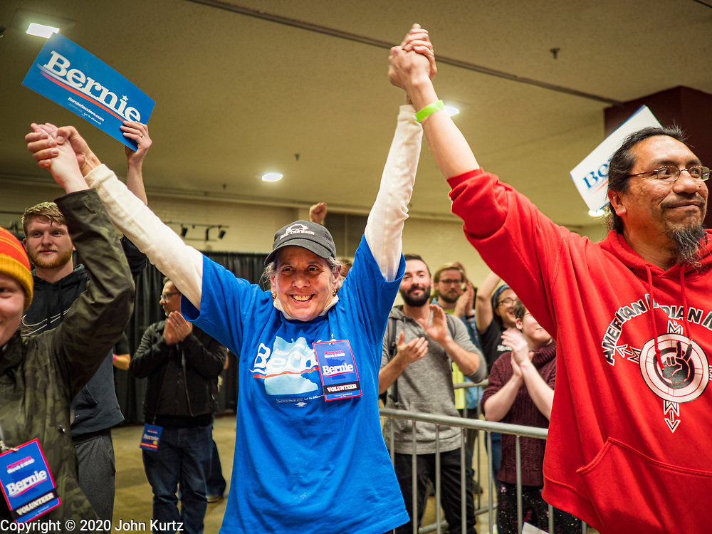 02 MARCH 2020 - ST. PAUL, MINNESOTA: People raise their hands in unity at a Bernie Sanders Get Out the Vote rally in the RiverCentre in St. Paul. More than 8,400 people attended the rally. Minnesota is a Super Tuesday state this year and Minnesotans will go to the polls Tuesday. Minnesota Sen. Amy Klobuchar was expected to win her home state, but she dropped out early Monday, March 2.        PHOTO BY JACK KURTZ