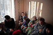 Patients in an adult mental asylum in the Mogliev region of Belarus. Chernobyl's human costs are widespread affecting about seven million people.A generation later children are being born with birth defects ,heart problems and thyroid cancer.The crippled economy of Belarus has led to poverty, social problems and domestic abuse..Photograph by Eamon Ward