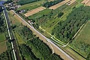 Nederland, Zuid-Holland, Gemeente Leerdam, 08-07-2010; Diefdijk tussen Leerdam en Schoonrewoerd. De dijk maakt onderdeel uit van Nieuwe Hollandse Waterlinie en omdat de dijk doorsneden wordt door de spoorlijn Leerdam-Geldermalsen is er een fort gebouwd (naam Werk op de spoorweg ). De Diefdijk is verder een binnendijk en oorspronkelijk aangelegd om de Alblasserwaard en de Vijfherenlanden tegen wateroverlast uit de Betuwe te beschermen. .Diefdijk. The inner dike was originally built to protect the polders Alblasserwaard and Vijfherenlanden against flooding from the Betuwe. In addition, the dike is part of the New Dutch Waterline, hence the fortress which protects the 'breach' made by the railway..luchtfoto (toeslag), aerial photo (additional fee required).foto/photo Siebe Swart