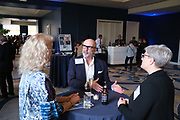 Drew Brugal talks with others during the Silicon Valley Business Journal's Women of Influence event at the Fairmont San Jose in San Jose, California, on May 16, 2019. (Stan Olszewski for Silicon Valley Business Journal)