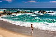 Local Girl On The Beach Fixing Her Bikini In Laguna Beach