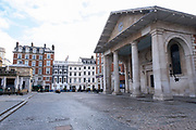 With very few people out and about the scene at Covent Garden piazza is one of empty desolation as the national coronavirus lockdown three continues on 29th January 2021 in London, United Kingdom. Following the surge in cases over the Winter including a new UK variant of Covid-19, this nationwide lockdown advises all citizens to follow the message to stay at home, protect the NHS and save lives.